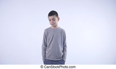 Sad brunette kid over isolated white background