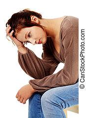 Sad brunette thinking and touching her head. - Sad caucasian...