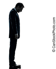 sad business man looking down silhouette - one caucasian sad...