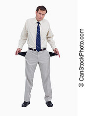 Sad businessman showing his empty pockets