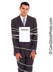 sad businessman tied with contract