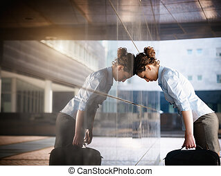 sad businesswoman - mid adult italian woman banging her head...