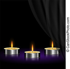sad candles - on a black background are three burning...