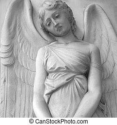 sad cemetery angel relief on monumental italian churchyard, ...