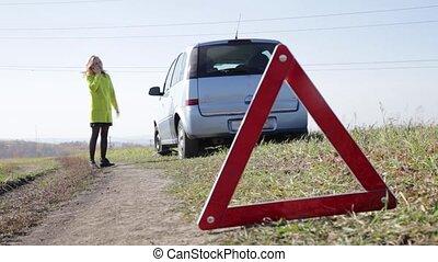 sad charming business woman near broken car on rural road is...