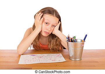 Sad child lack of ideas - Sad child sitting at a table lack...