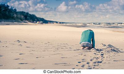 Sad child on a beach