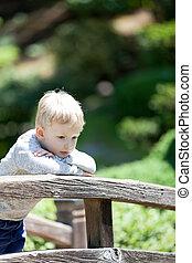 sad child outdoors