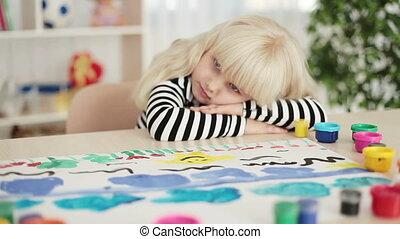 Sad child painting