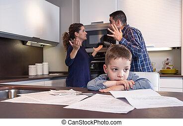 Sad child suffering and parents having discussion