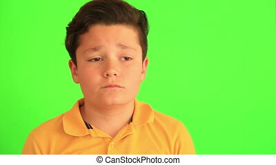 Sad child with choma green screen