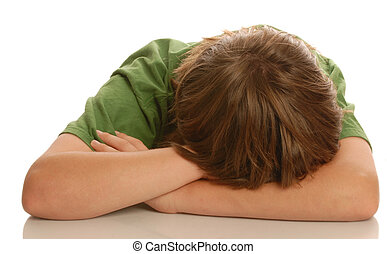sad child - young teenage boy with head down in arms