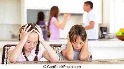 Sad children listening to their parents