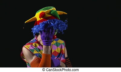 Sad clown crying and blowing nose - Young funny sad clown...
