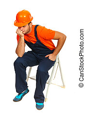 Sad constructor worker sitting and waiting on step ladder...