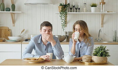 sad couple girl guy have breakfast drinking tea silently - ...