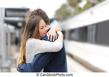 Sad couple saying goodbye before travel - Sad couple hugging...