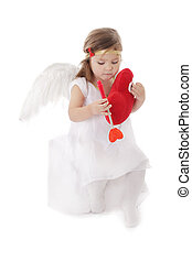 Sad cupid girl sitting with heart