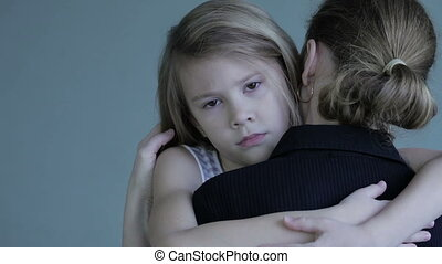 sad daughter hugging his mother at home. Concept of couple...