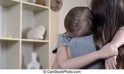Sad daughter tightly hugging her mother telling about her problems, mother love