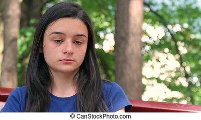 Sad, depressed beautiful teen girl