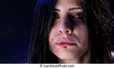 Sad desperate woman crying - Leonely beaten woman in dark