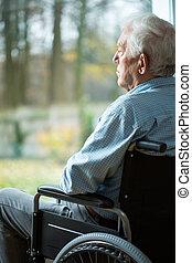 Sad disabled man