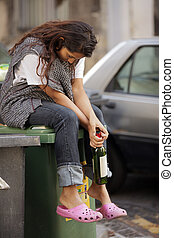 sad drunk homeless woman