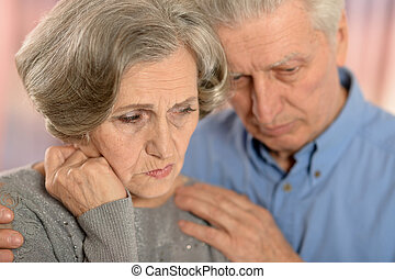 Sad elder couple