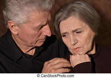 Sad elder couple - Close-up portrait of sad elder couple on...