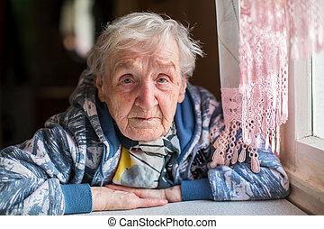 Sad elderly woman portrait