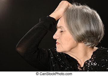 Sad elderly woman