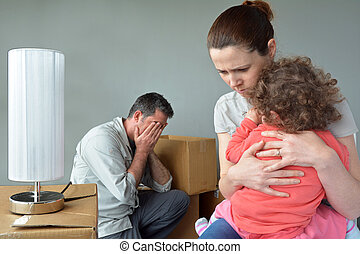 Sad evicted family worried relocating house. Moving house concept. Real people. copy space