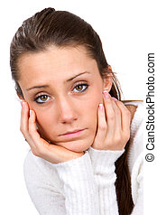 Sad Faced Woman - Sad faced young woman holds her face in...
