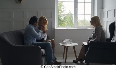Sad family having a visit to psychologist