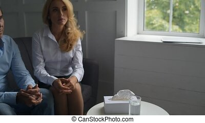 Sad family recovering their relationships at psychologists office