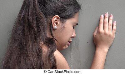 Sad Female Teen Alone And Crying