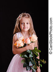 Sad five year old girl with a bouquet of flowers