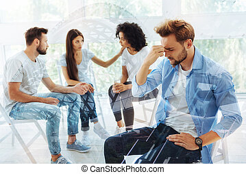 Sad friends having discussion with psychologist