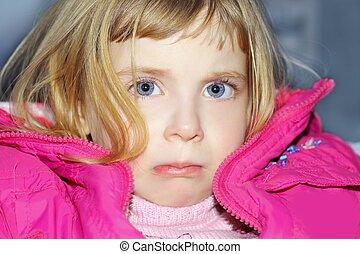 sad gesture in blond little girl portrait