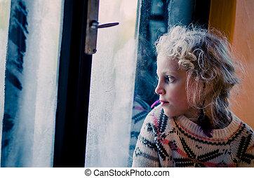 sad girl by window