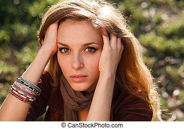 sad girl hands in hair closeup