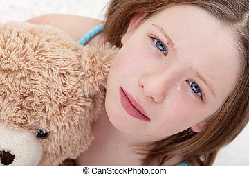 Sad girl holding teddy bear and crying - Beautiful sad girl...