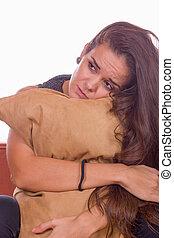 sad girl hugging pillow