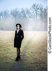 Sad girl in a short coat