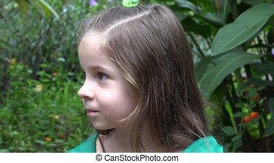 Sad Girl in Flower Garden