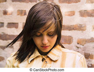 Sad girl looking down