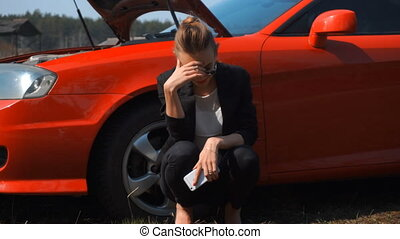 sad girl near red broken car