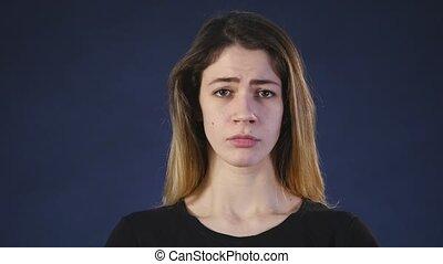 sad girl on a dark background.