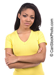 Sad girl. Portrait of beautiful African descent women expressing negativity and holding her arms crossed while isolated on white